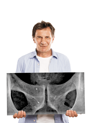 Man holding prostate X-ray sheet